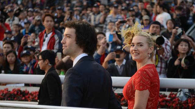 L'actrice britannique Kate Winslet et Ned Rocknroll le 9 décembre 2012 à Hong Kong [Antony Dickson / AFP/Archives]