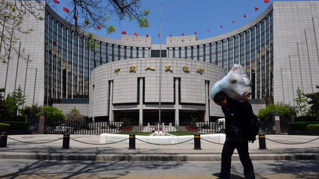 Un travailleur migrant chinois à Pékin, le 1er mai 2013 [Mark Ralston / AFP/Archives]
