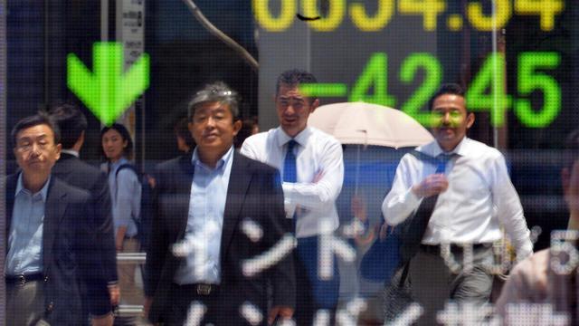 Un tableau de changes à Tokyo, le 27 mai 2013 [Yoshikazu Tsuno / AFP]