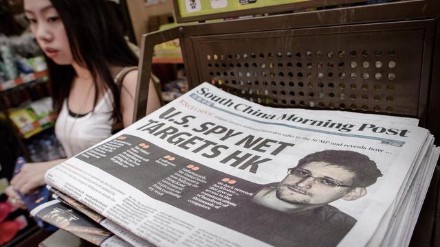 Edition du South China Morning Post évoquant l'affaire Snowden, le 13 juin 2013 à Hong Kong [Philippe Lopez / AFP]