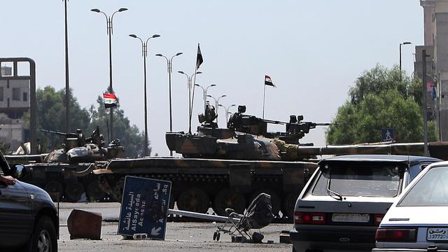 De violents combats ont éclaté vendredi entre soldats syriens et rebelles dans le quartier d'al-Qazzaz, dans le sud-est de Damas, où les forces de sécurité ont arrêté des dizaines de jeunes hommes, a rapporté l'Observatoire syrien des droits de l'Homme (OSDH). [AFP]