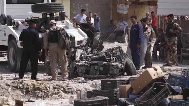 Epave d'une voiture piégée en Irak [ / AFP/Archives]