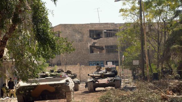 Des chars de l'armée syrienne dans Alep, le 27 septembre 2012 [ / AFP]