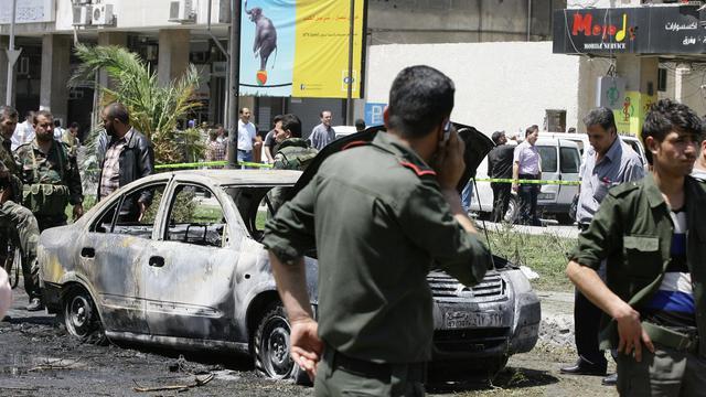 Attentat le 30 avril 2013 dans le quartier de Marjeh à Damas [Louai Beshara / AFP/Archives]