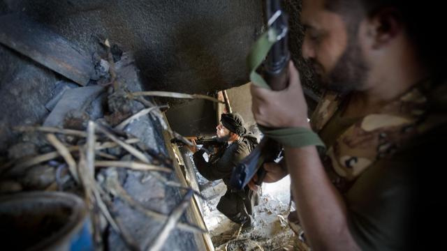 Des rebelles syriens armés, le 22 mai 2013 à Alep [Ricardo Garcia Vilanova / AFP/Archives]
