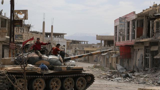 Un char de l'armée syrienne dans Qoussair en Syrie, le 7 juin 2013 [ / AFP/Archives]