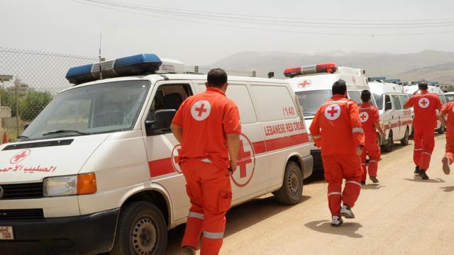 Des volontaires de la Croix rouge libanaise dans la vallée de la Békaa, le 8 juin 2013 [- / AFP/Archives]