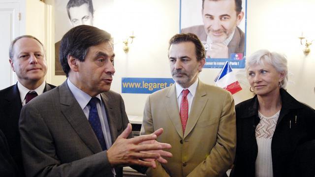 Jean-François Legaret (2e d) au côté de François Fillon (2eg) et Françoise de Panafieu (d), le 7 juin 2007 à Paris [Stephane de Sakutin / AFP/Archives]