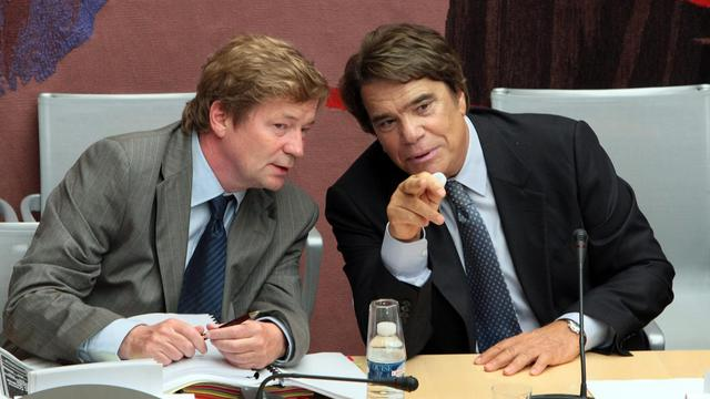 Bernard Tapie (D) et son avocat Me Maurice Lantourne, le 10 septembre 2008 à Paris [Jacques Demarthon / AFP/Archives]