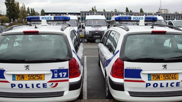 Voitures de police à Saint-Denis [Jacques Demarthon / AFP/Archives]