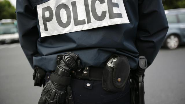 Un policier en faction le 9 juin 2009 à Paris [Loic Venance / AFP]