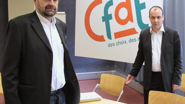 Le secrétaire général de la CFDT, François Chérèque (g) et le secrétaire national, Laurent Berger (d), le 16 avril 2010, au siège de la CFDT à Paris [Jacques Demarthon / AFP/Archives]