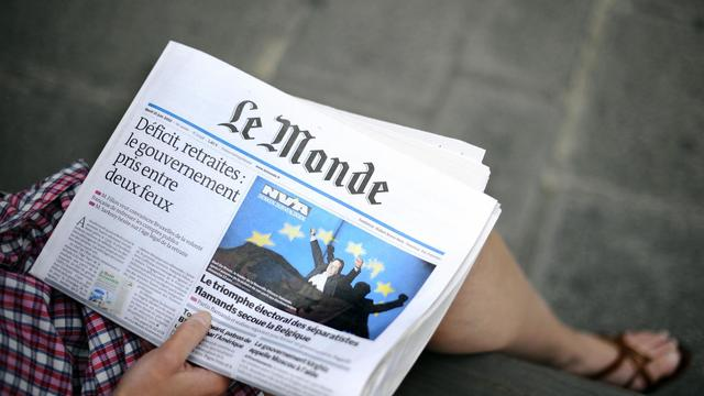 Un exemplaire du quotidien du monde [Johanna Leguerre / AFP/Archives]