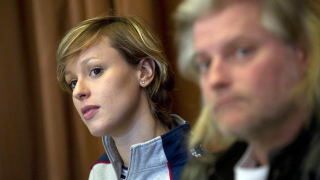 L'entraîneur Philippe Lucas et la nageuse italienne Federica Pellegrini, lors d'une conférence de presse, le 3 février 2011, à Paris. [Bertrand Langlois / AFP]