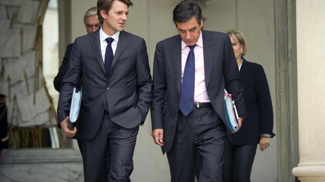 L'ex-ministre François Baroin (g) et l'ex-Premier ministre François Fillon (d), le 5 octobre 2011 à Paris [Lionel Bonaventure / AFP/Archives]
