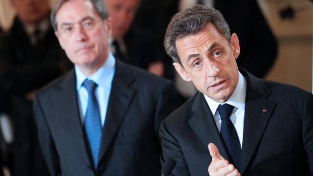 L'ex-président Nicolas Sarkozy et Claude Guéant (en arrière-plan), le 13 avril 2012 à Ajaccio [Pascal Pochard-Casabianca / AFP/Archives]