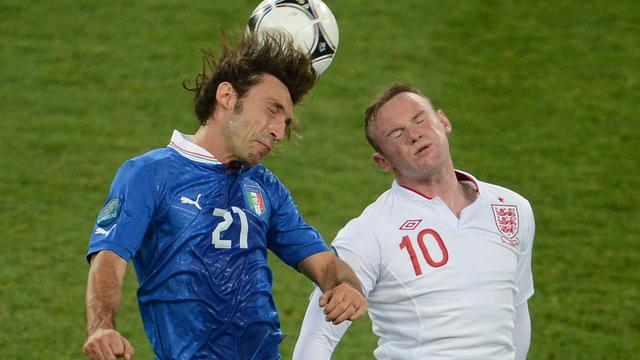 Italian midfielder Andrea Pirlo (L) vies with English forward Wayne Rooney during the Euro 2012 football championships quarter-final match England vs Italy on June 24, 2012 at the Olympic Stadium in Kiev. AFP PHOTO/ JEFF PACHOUD[AFP]