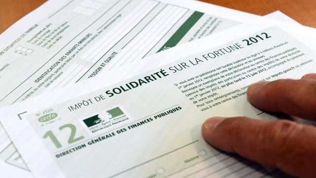 Photo prise d'un imprimé de déclaration de l'impôt de solidarité sur la fortune (ISF) pour l'année 2012, le 19 juillet 2012 à Rennes [Damien Meyer / AFP/Archives]