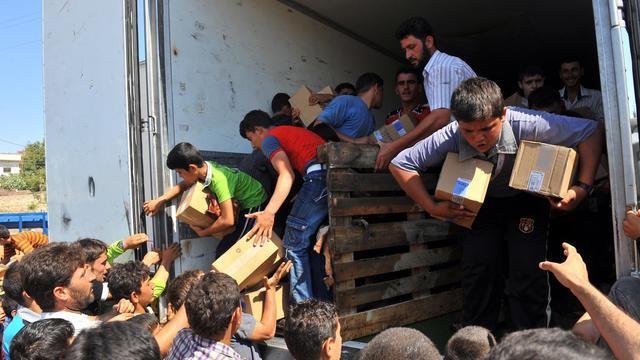 """L'économie syrienne est totalement éreintée après 17 mois de révolte mais peut encore tenir, malgré les sanctions, grâce à l'aide de """"pays amis"""" comme la Russie, l'Irak, l'Iran ou le Venezuela, selon des experts.[AFP]"""