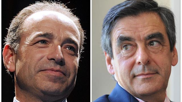 """Les deux principaux rivaux à la présidence de l'UMP, François Fillon et Jean-François Copé, ont fait samedi campagne sans se croiser au """"campus de la reconquête"""" des jeunes UMP au Touquet. [AFP]"""