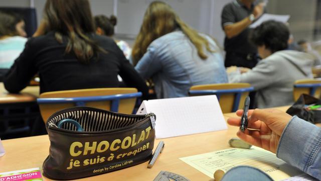 Des élèves écoutent leur professeur dans un lycée [Frank Perry / AFP/Archives]