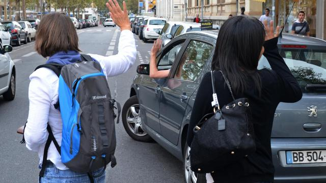 Des participants à un système de covoiturage [Philippe Desmazes / AFP/Archives]