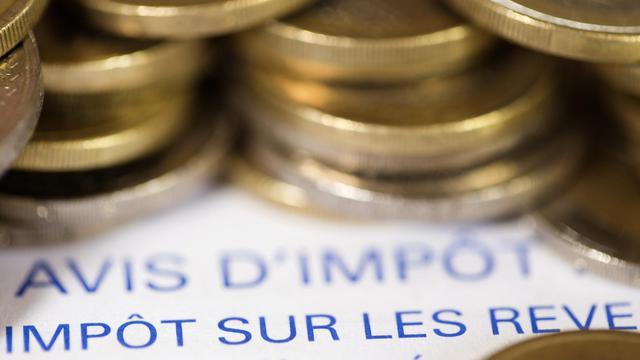 Les hausses d'impôts annoncées par François Hollande aux ménages pour l'an prochain toucheront en priorité les plus riches, mais peu de foyers imposables y échapperont, selon les spécialistes. [AFP]
