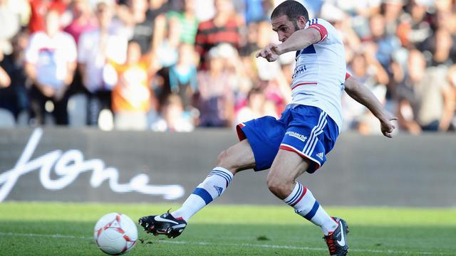 Lisandro marque le second but de Lyon contre Ajaccio en Ligue 1 le 16 septembre 2012 au stade de Gerland [Jeff Pachoud / AFP]