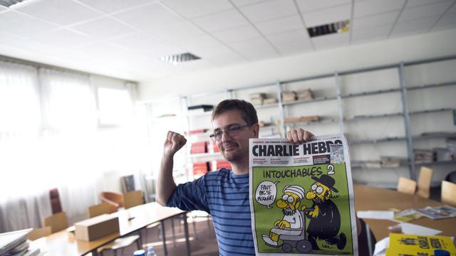 Charb, le directeur de Charlie Hebdo, le 19 septembre 2012 à Paris [Fred Dufour / AFP]