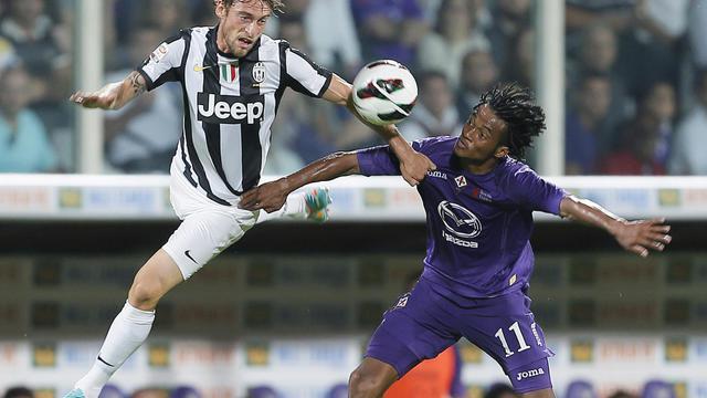 Le joueur de la Juventus Turin Claudio Marchisio (gauche) et celui de la Fiorentina Juan Cuadrado, lors du match de championnat entre les deux équipes le 25 septembre 2012 à Florence. [Fabio Muzzi / AFP]