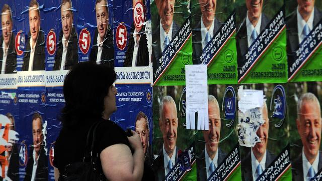 Affiches électorales le 30 septembre 2012 à Tbilissi [Andrey Smirnov / AFP]