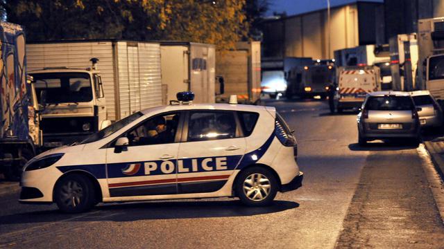 Une voiture de police bloque une rue d'Aubervilliers [Mehdi Fedouach / AFP/Archives]