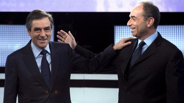 L'ex-Premier ministre François Fillon et le président de l'UMP Jean-François Copé, le 25 octobre 2012 à Paris [Miguel Medina / AFP/Archives]