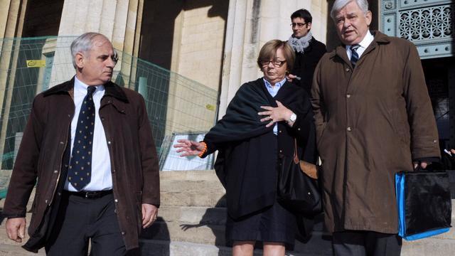"""Des membres de la famille Vedrine, victime du """"gourou"""" Thierry Tilly, à Bordeaux, le 13 novembre 2012 [Jean-Pierre Muller / AFP/Archives]"""