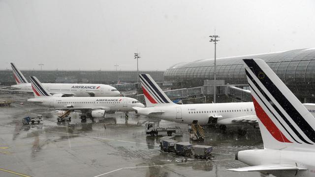 Des avions de la compagnie Air France à l'aéroport Roissy Charles-de-Gaulle, en région parisienne [Eric Piermont / AFP/Archives]