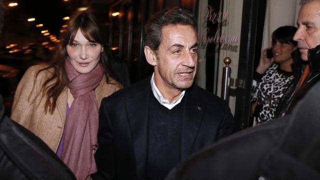 Nicolas Sarkozy et son épouse Carla Bruni-Sarkozy, le 28 janvier 2013 à Paris [Kenzo Tribouillard / AFP/Archives]