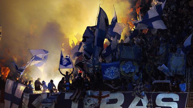 Des supporters de Marseille lors d'un match contre Lyon [Philippe Merle / AFP/Archives]