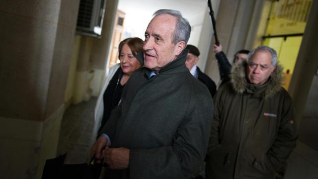 L'ancien maire de Paris Jean Tiberi (c) et sa femme Xavière, le 12 mars 2013 à Paris [Lionel Bonaventure / AFP/Archives]