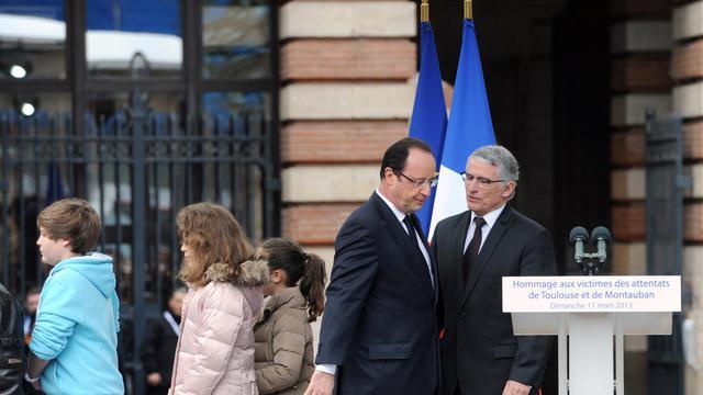 Le maire de Toulouse, Pierre Cohen, au côté du président de la République, le 17 mars 2013 à Toulouse [Eric Cabanis / AFP/Archives]