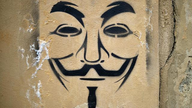 Le masque de Guy Fawkes tagué sur un mur, à Florence, le 6 avril 2013 [Gabriel Bouys / AFP/Archives]