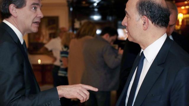 Arnaud Montebourg, et Pierre Moscovici le 11 avril 2013 à Paris [Jacques Demarthon / AFP/Archives]