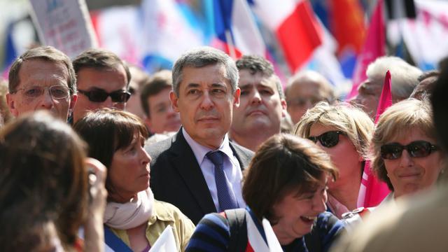Le député UMP Henri Gaino (c) lors d'une manifestation contre le mariage pour tous, le 21 avril 2013 à Paris [Thomas Samson / AFP/Archives]