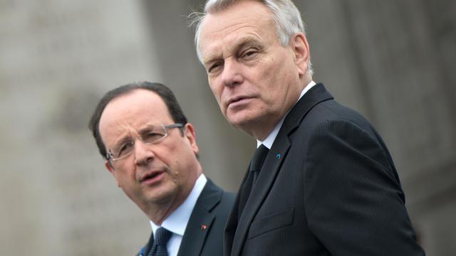 Le président François Hollande et son Premier ministre Jean-Marc Ayrault le 8 mai 2013 à Paris [Bertrand Langlois / AFP]