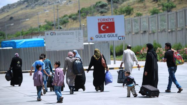 Des réfugiés syriens en Turquie rentrent dans leur pays après un attentat dans la province de Hatay, le 14 mai 2013 [Bulent Kilic / AFP/Archives]