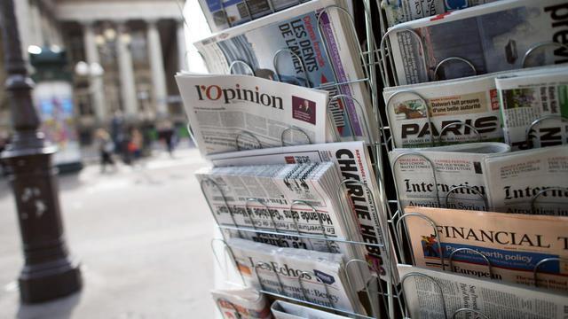 Des journaux dans un kiosque [Fred Dufour / AFP/Archives]