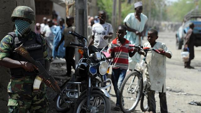 Photo prise le 30 avril 2013 de soldats en patrouille à Baga, au Nigeria [Pius Utomi Ekpei / AFP/Archives]