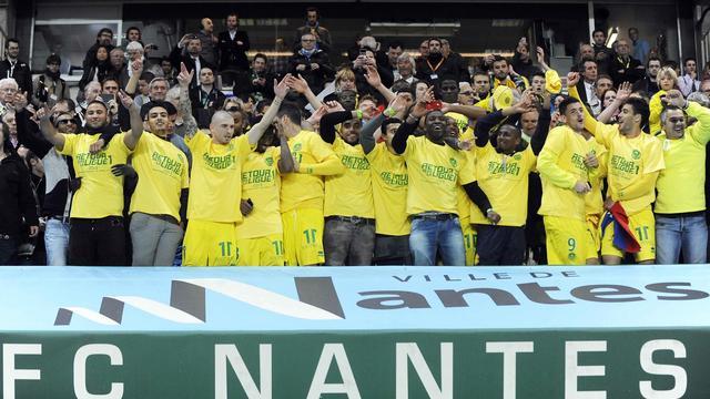 Les joueurs de Nantes célèbrent l'accession du club en Ligue 1 le 17 mai 2013 [Jean-Sebastien Evrard / AFP]