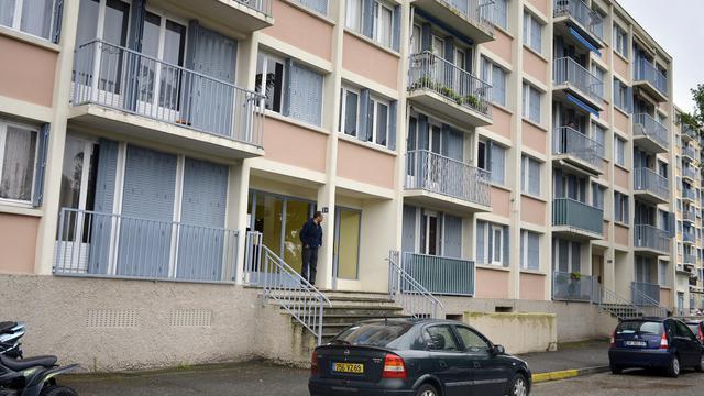 Photo prise le  le 19 mai 2013 de l'immeuble où ont été retrouvés les deux enfants égorgés à Saint-Priest (Rhône-Alpes) [Jeff Pachoud / AFP]
