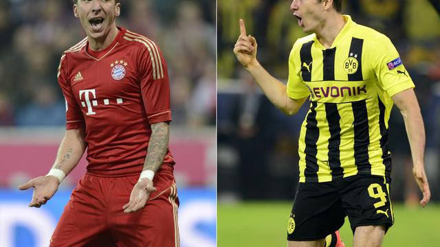 L'attaquant croate du Bayern Munich Mario Mandzukic (g) et son homologue polonais de Dortmund Robert Lewandowski (d). [Christof Stache / AFP/Archives]