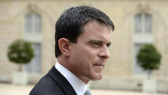 Le ministre de l'Intérieur, Manuel Valls, quitte le palais de l'Elysée, le 29 mai 2013 à Paris [Eric Feferberg / AFP/Archives]